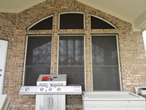 Displaying three arched solar window screens.